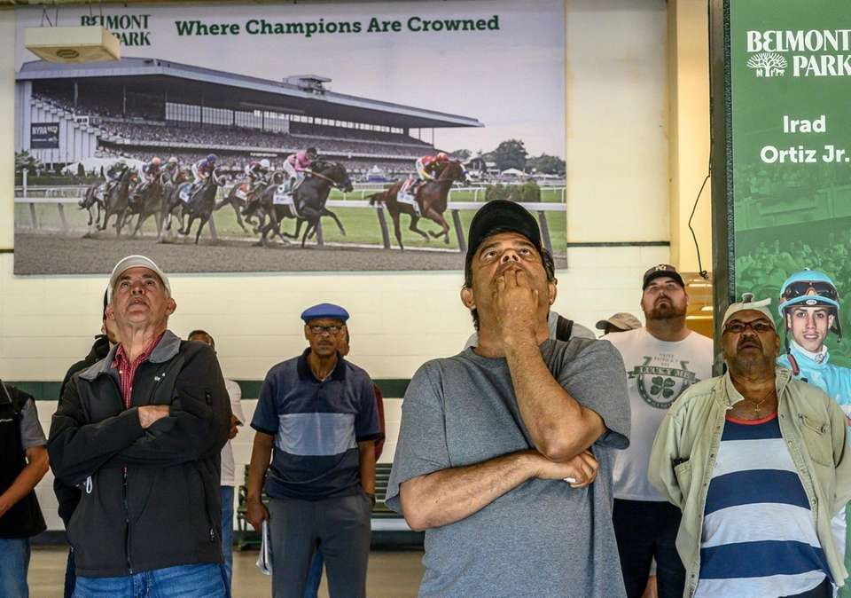 Horse racing enthusiasts watching the monitors during at