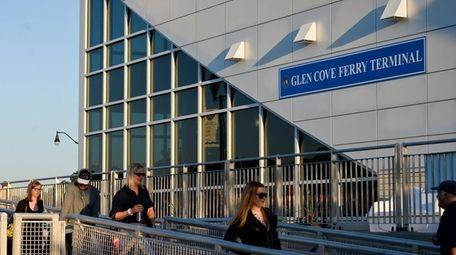 Manhattan-bound commuters board a ferry at the Glen