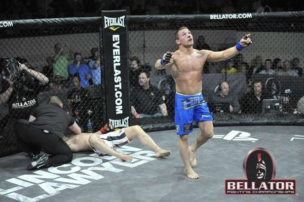 Mike Chandler, right, celebrates his first-round submission victory