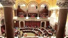 Members of the New York State Senate work