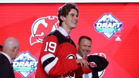 Jack Hughes smiles after being selected first overall