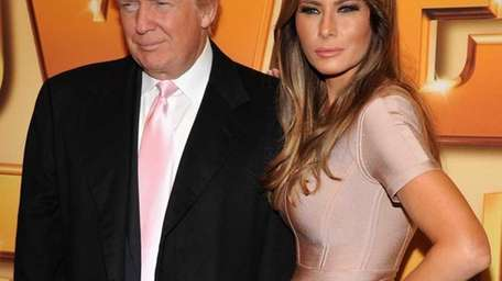 Donald Trump and Melania Trump attend the world