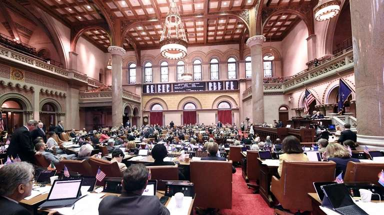 Members of the Assembly discuss legislation in the