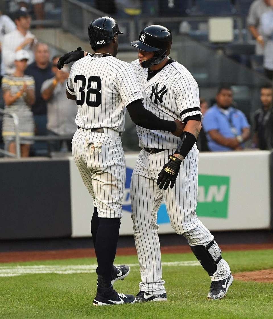 New York Yankees' Gary Sanchez, right, is embraced