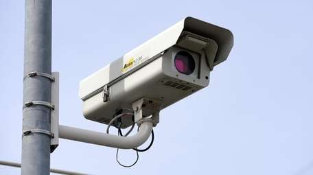 Red light traffic camera at the intersection of
