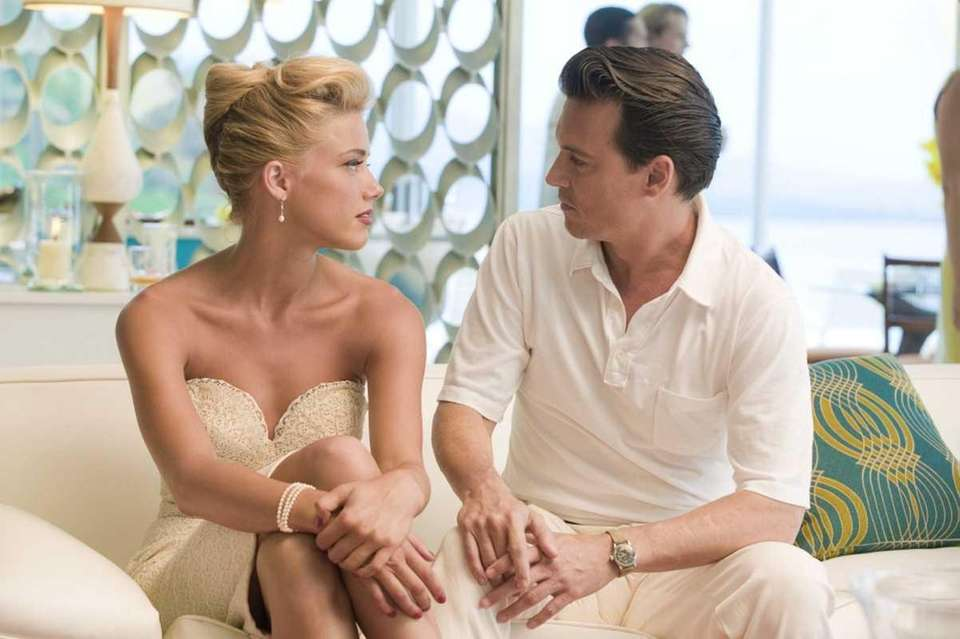 Amber Heard and Johnny Depp are pictured in