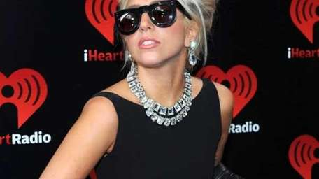 Lady Gaga poses backstage at the iHeartRadio Music