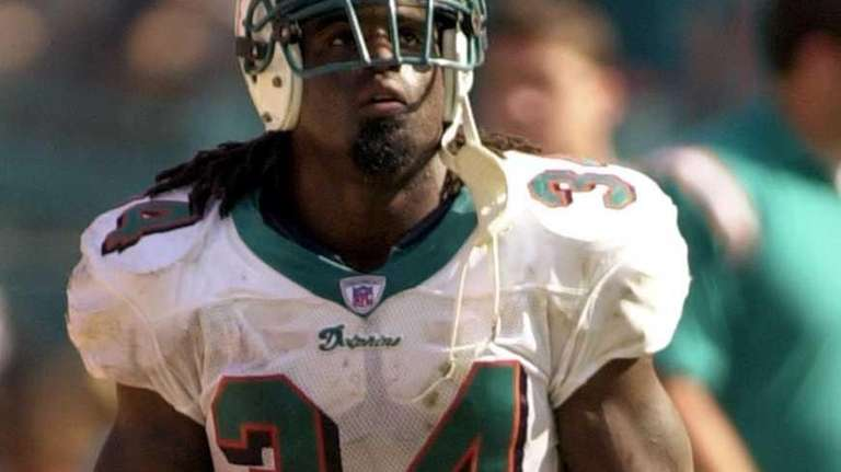 Miami Dolphins running back Ricky Williams looks up