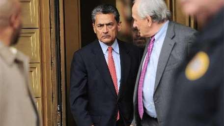 Rajat Gupta leaves federal court in New York.