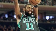 Celtics guard Kyrie Irving dunks against the Knicks