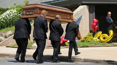 The casket of Melissa Marchese is carried into