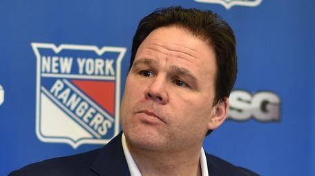 Rangers GM Jeff Gorton speaks with the media
