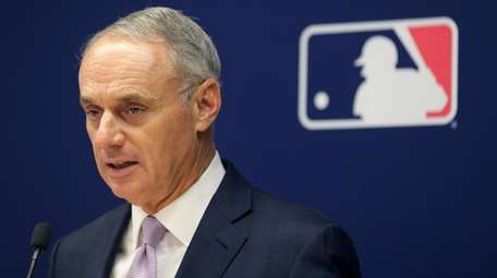 Major League Baseball commissioner Rob Manfred speaks to
