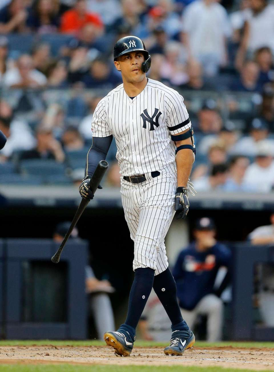 The Yankees' Giancarlo Stanton strikes out during the