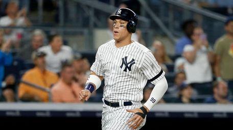 Aaron Judge of the Yankees scores a run
