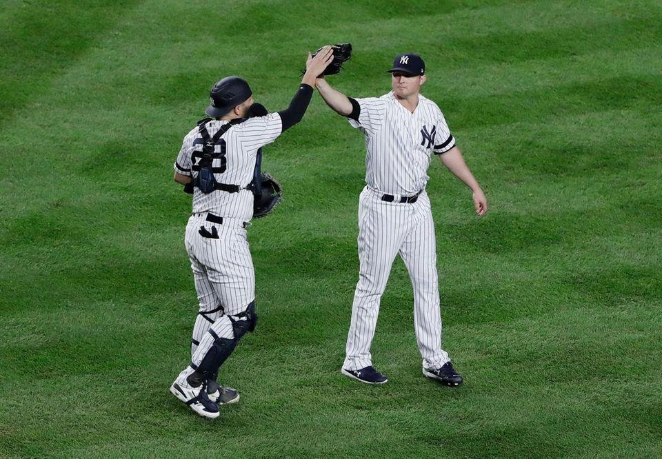 New York Yankees relief pitcher Zack Britton, right,