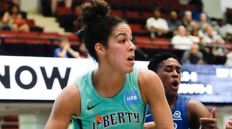 The Liberty's Kia Nurse, left, looks to pass