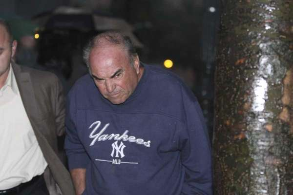 Joseph Rutigliano, a retired LIRR employee, exits federal