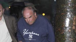 Joseph Rutigliano, a retired LIRR employee, exits federal