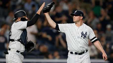Zack Britton and Austin Romine of the Yankees
