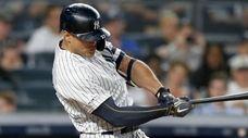 Giancarlo Stanton of the Yankees follows through on