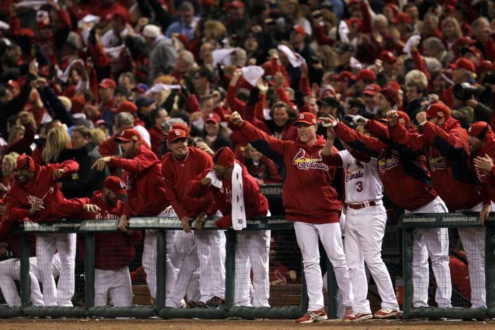 The St. Louis Cardinals bench celebrate after Lance