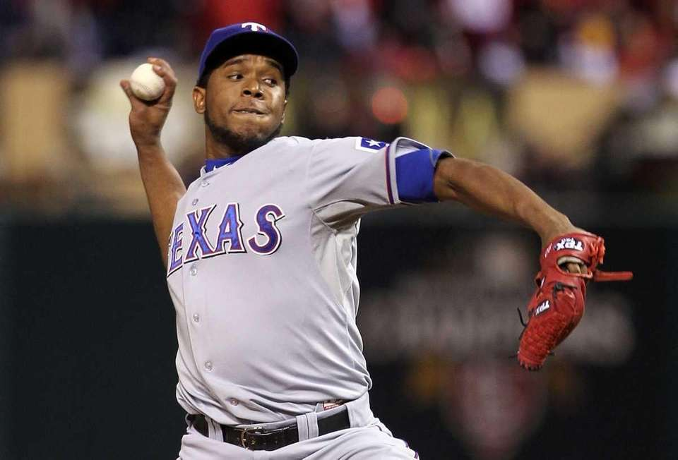 Neftali Feliz pitches in the ninth inning during