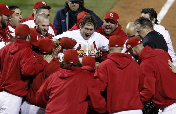 Teammates celebrate with St. Louis Cardinals' David Freese