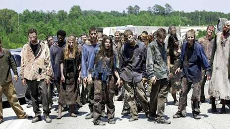 In this image released by AMC, zombies appear