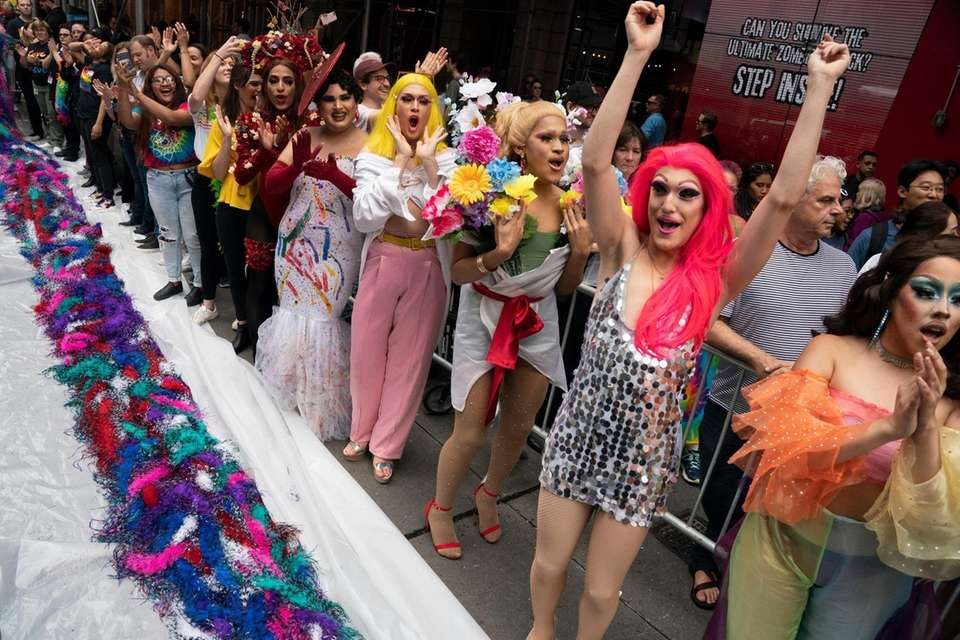 Drag queens celebrate on West 42nd Street after