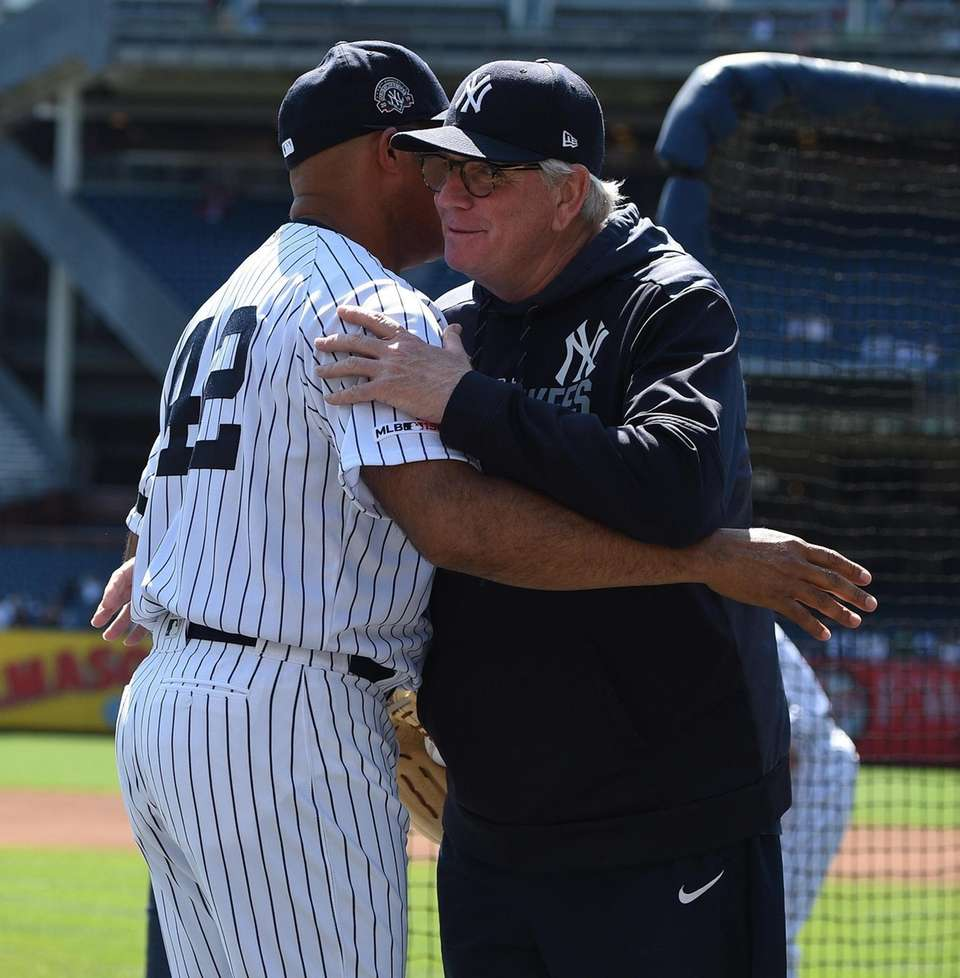 New York Yankees pitching coach Larry Rothschild embraces