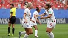 Alex Greenwood of England celebrates with teammate Fran