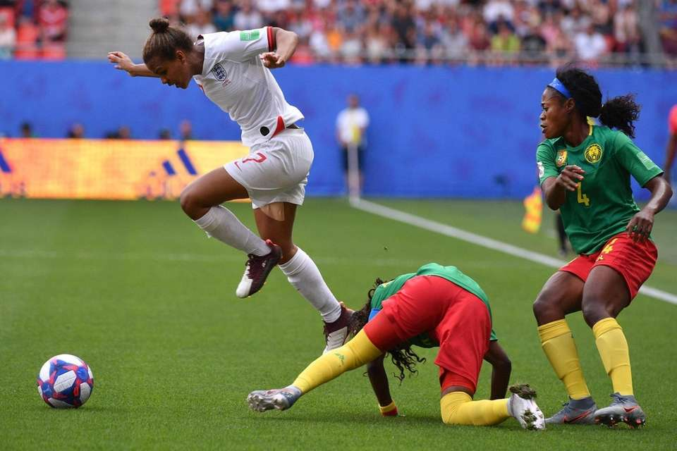England's forward Nikita Parris (L) vies with Cameroon's