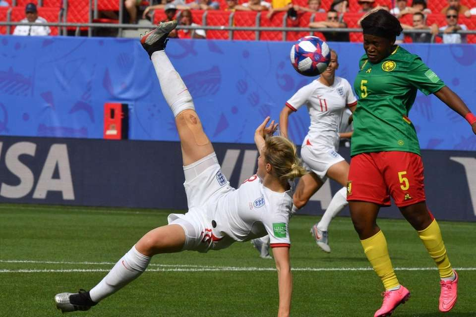 England's forward Ellen White (L) vies with Cameroon's