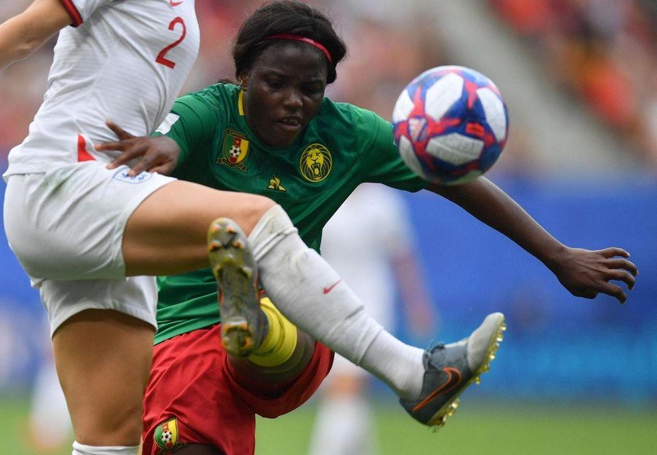 Cameroon's midfielder Raissa Feudjio (C) vies with England's