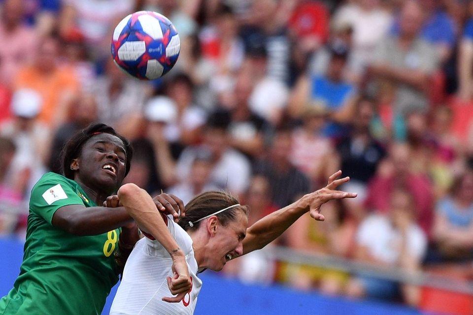 Cameroon's midfielder Raissa Feudjio (L) vies with England's