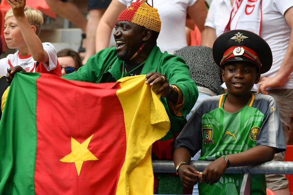 Cameroonian supporters cheer their team during the France