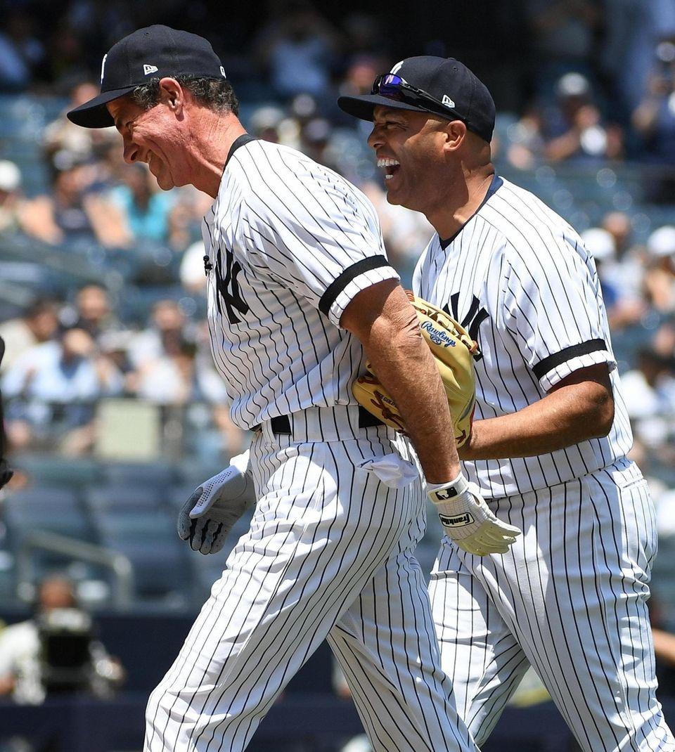 Former Yankees players Marino Rivera, right, and Paul