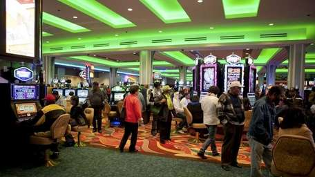 Guests gamble inside the new Resorts World Casino