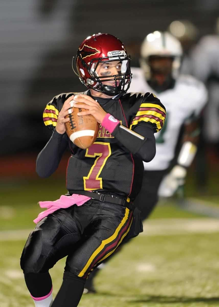 Sachem's Anthony Riggi looks to pass downfield during