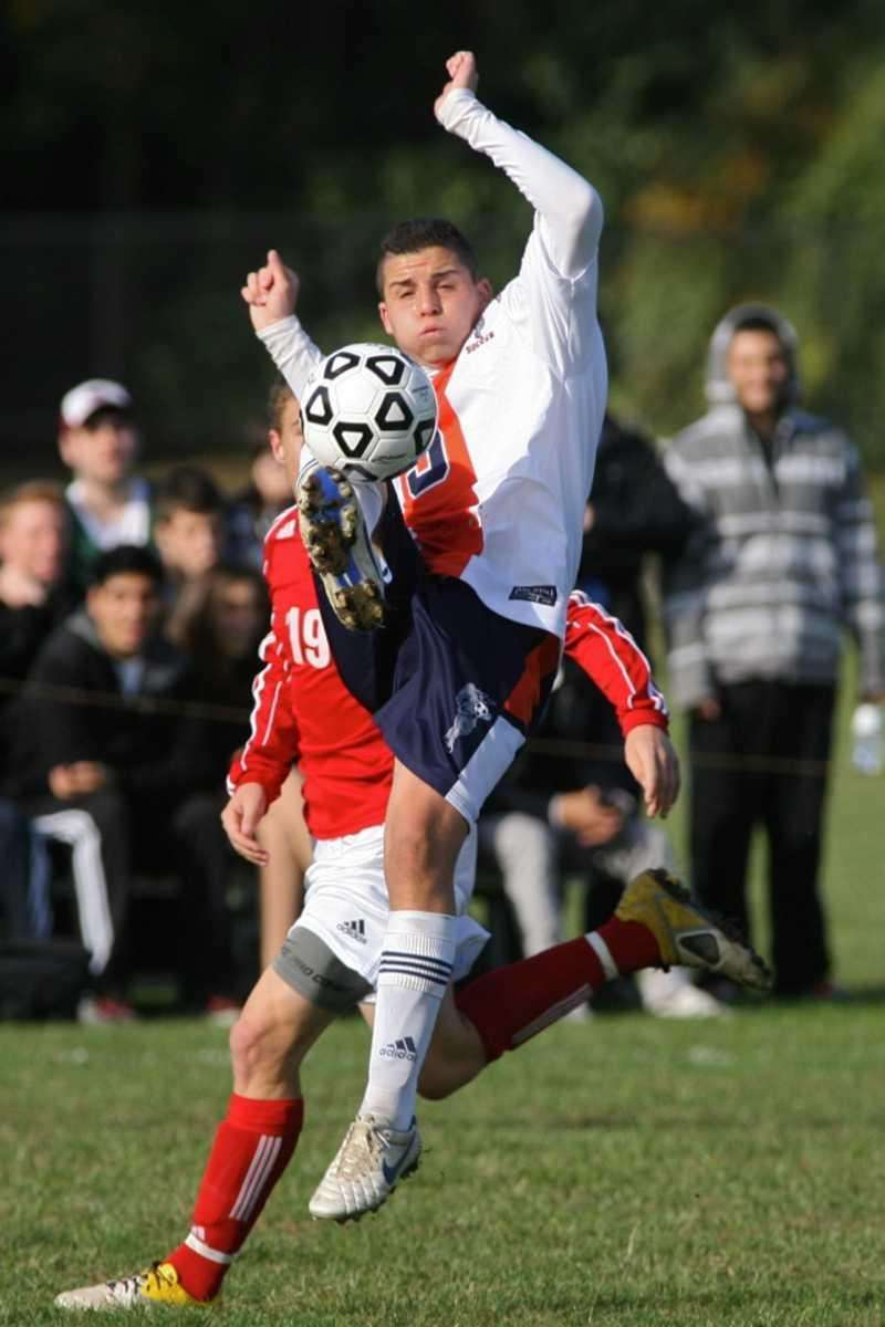 Great Neck North HS's #9 Alan Golman defends
