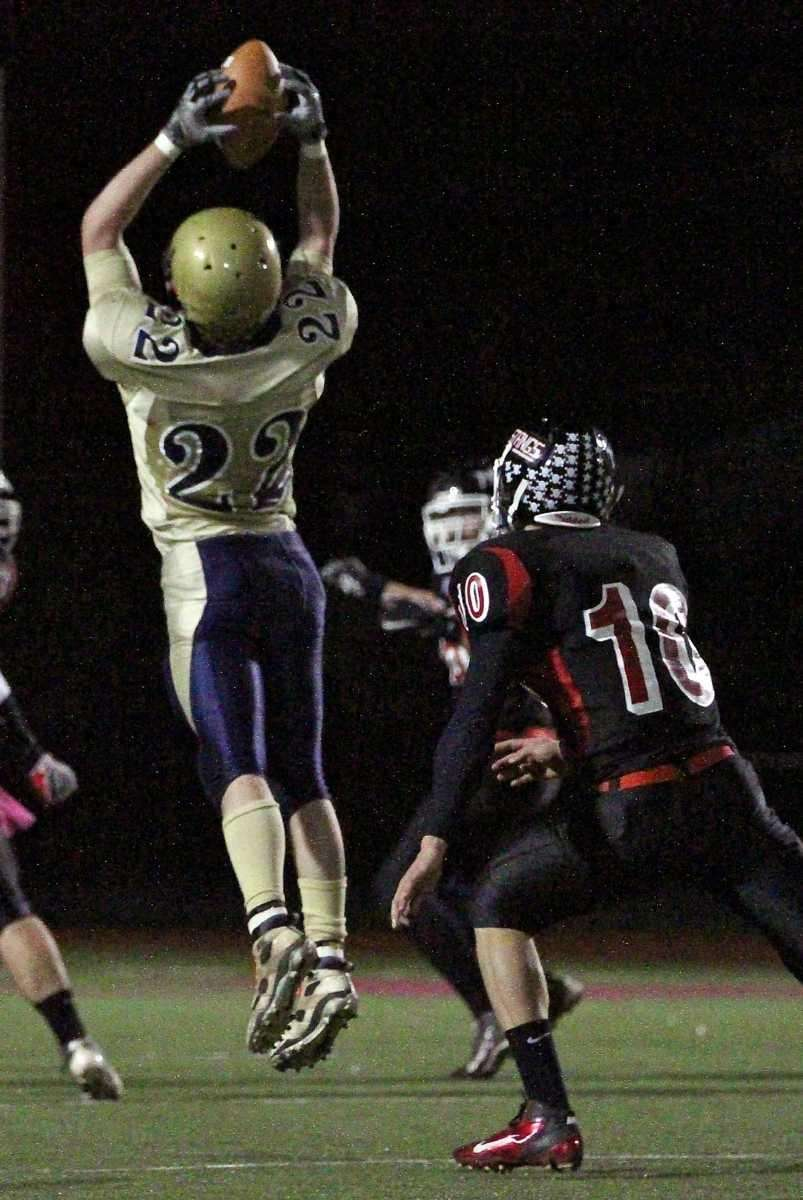 Shoreham WR Dylan Bates #22 grabs the high