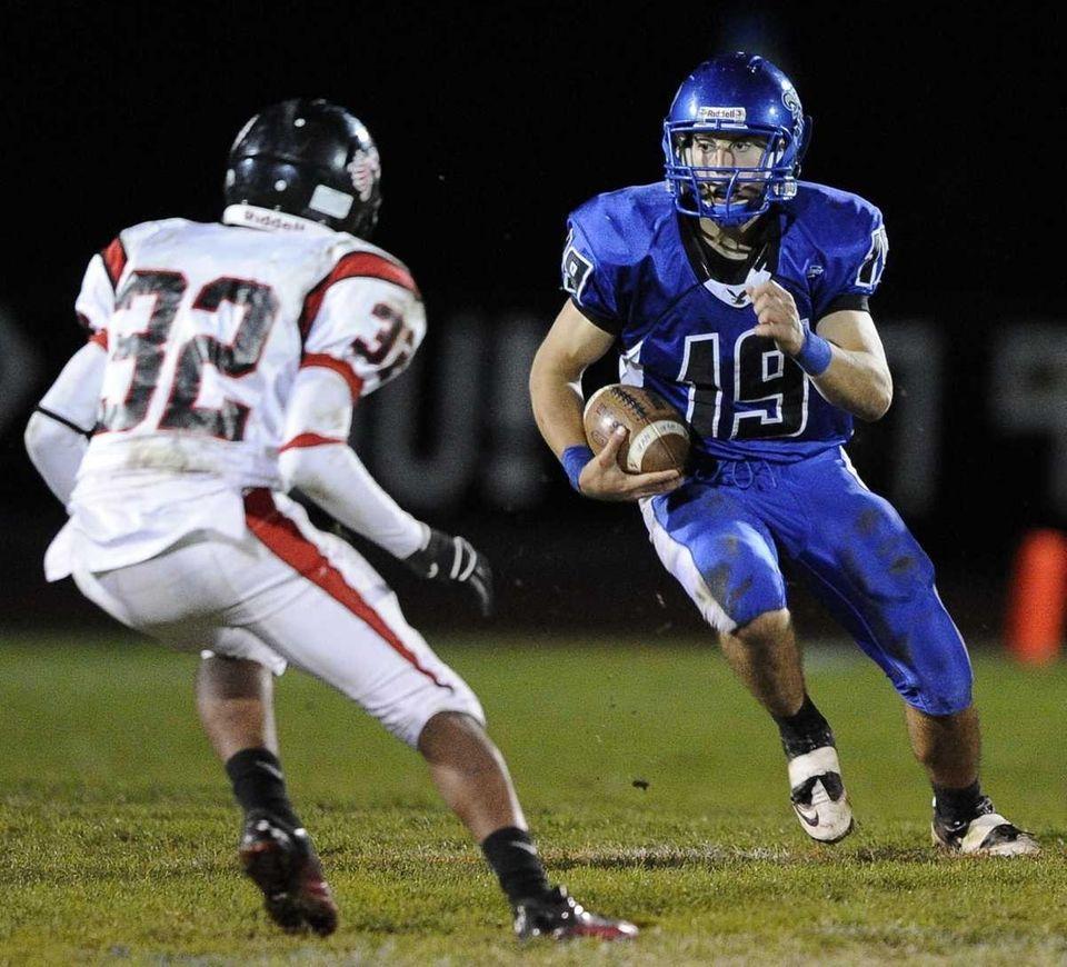 Hauppauge quarterback Corey Wood looks to move around