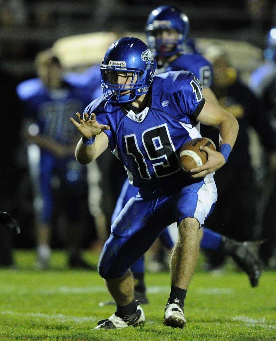 Hauppauge quarterback Corey Wood looks for an opening