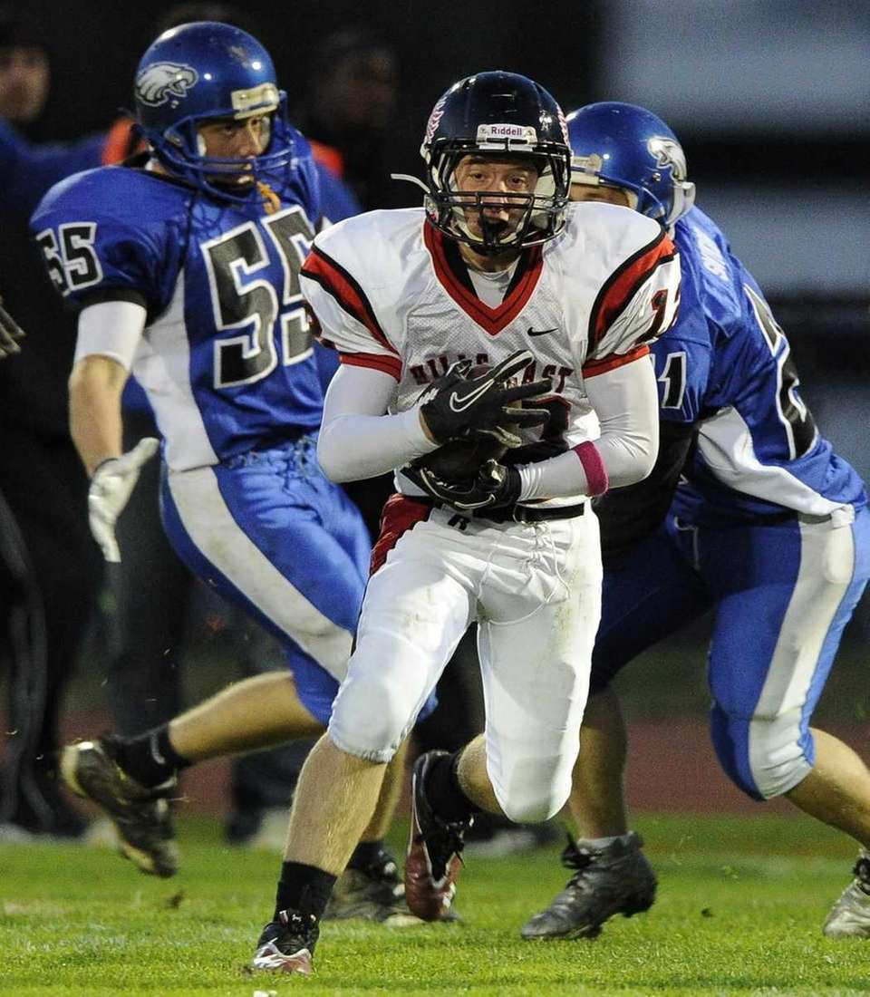 Half Hollow Hills East's Justin Ashley carries the