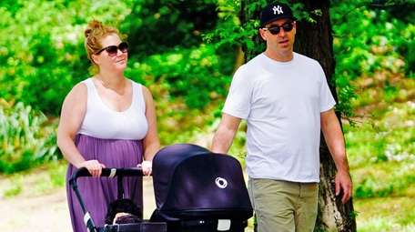 Amy Schumer and husband Chris Fischer take infant