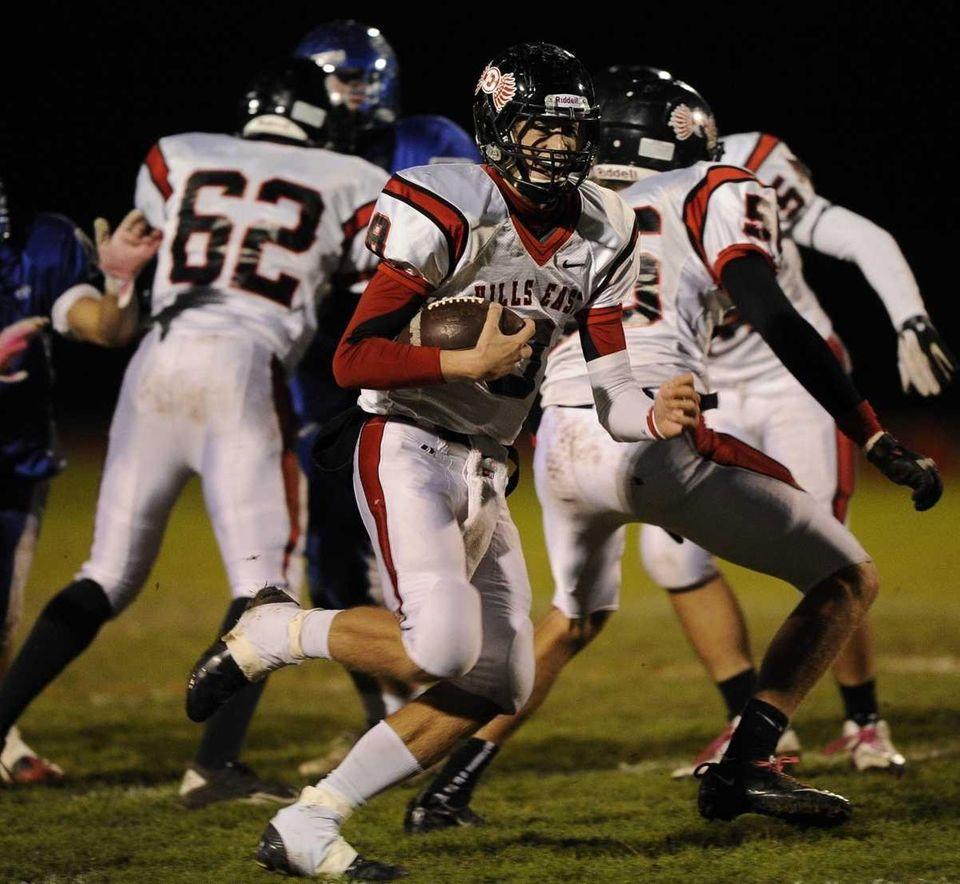 Half Hollow Hills East's defense protects quarterback RJ