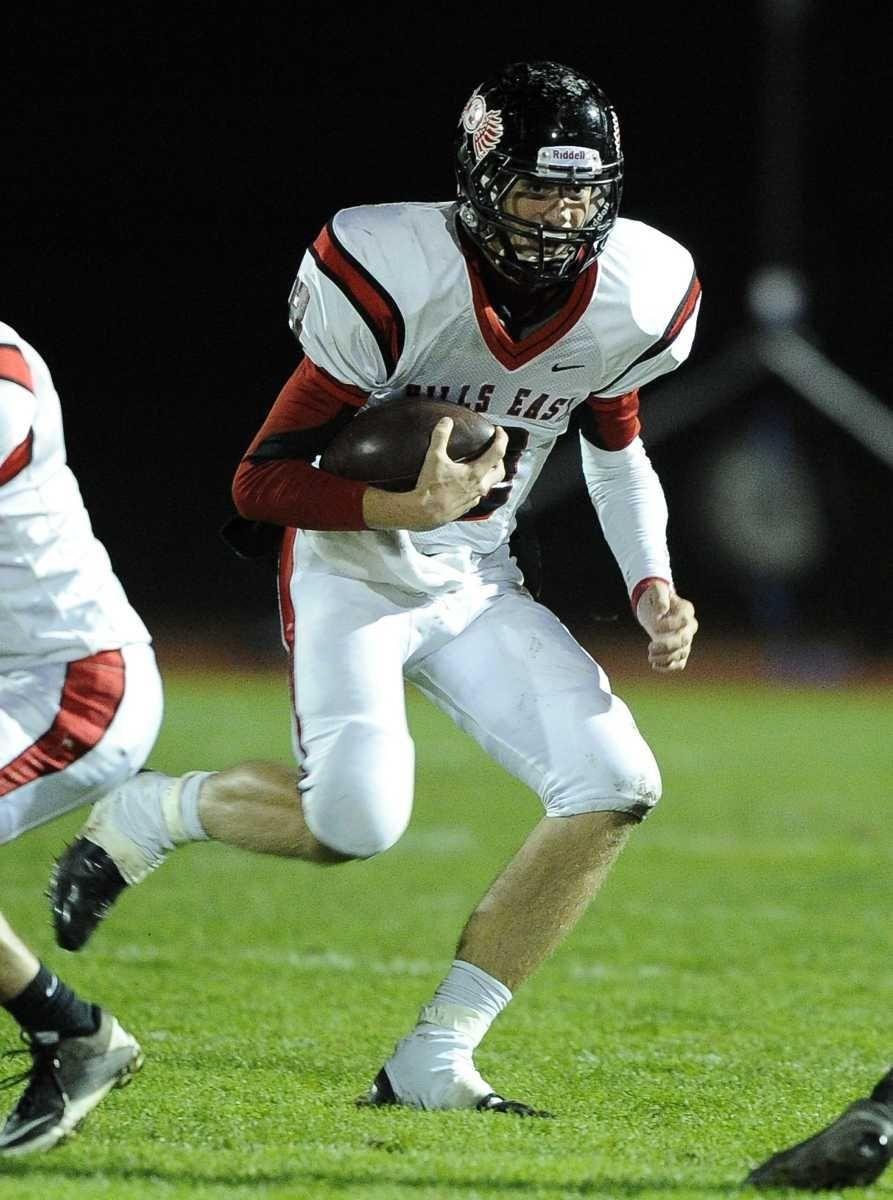 Half Hollow Hills East quarterback RJ Nitti runs
