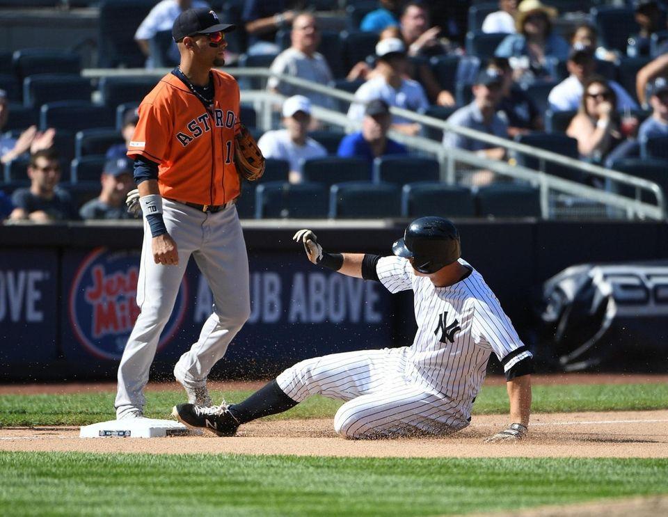 New York Yankees third baseman DJ LeMahieu slides