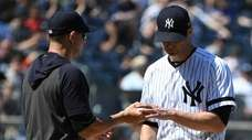 Yankees manager Aaron Boone takes the ball from